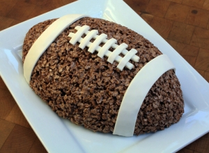 However, though this might be the size of a real football, doesn't mean you should pass it around with your guests. Seriously, don't.