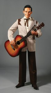 Looks like the late country music legend Hank Williams is back from the dead as a Satanic puppet that sings his country ballads and has people sell him their souls. Seriously, this wax rendition is just creepy as hell.