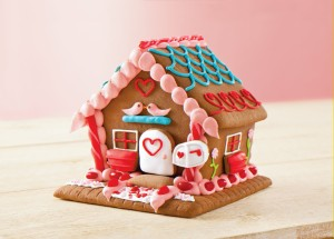 Sure gingerbread houses are mostly associated with Christmas. Yet, this one's a Valentine's Day one. Oh, and this one even has a little mailbox. Still, it's probably not for eating.