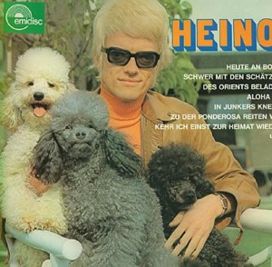 Okay, I don't know about you, but I fear for the dogs' safety if they had an owner like that. Still, since 1966, he's been one of Germany's most successful recording artists selling 50 million albums and still going strong. Also been married 3 times. He's even creepier without his glasses. Still, he must have something since he's put out a lot of albums with terrible covers.