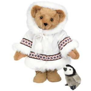 Though penguins are cute animals, they actually live in the Southern Hemisphere and don't coexist with Inuit or Arctic wildlife. Still, I love how that bear looks in its cute little parka.
