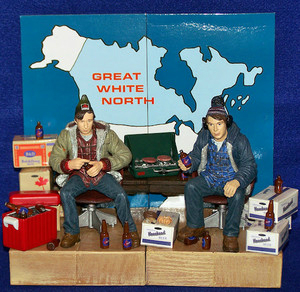 Both Bob and Doug come with their own chairs as well as cases and bottles of beer. Bob comes with cooler and donuts while Doug comes with camp stove and burgers. Great White North set sold separately.
