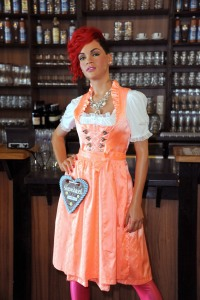 Seems like Rihanna is in her German barmaid outfit to celebrate Oktoberfest. Nevertheless, I just hope Chris Brown doesn't turn out at this location if she has a restraining order against him (like she should.)