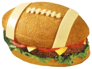 Now I'm sure this was made by a restaurant. I mean burgers don't tend to be that big. Then again, this might be a close up image. Nevertheless, the top bun certainly looks like a real football.