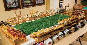 I see this one contains beer as I see it and other dishes. Still, I wonder if that grass is real. Looks like it compared to what I've seen on Cougar Mountain, that is. Also contains helmets from almost all the NFL teams.