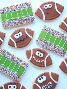 I don't know about you but I really like these expressions on these football. I also love the use of sprinkles for the crowds on the football stadium ones, too.