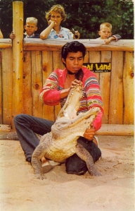 "Man, for an activity that should have big, ""Do Not Try This at Home"" disclaimer, seems that some people find alligator wrestling quite boring, indeed. People like me just find it nuts. Then again, while the boys are bored to tears, seems like Mom is just thinks the handler has a nice tight ass."