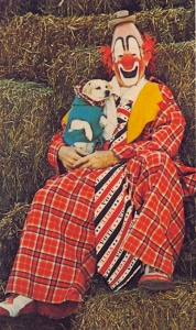 I don't know about you but upon seeing this picture, I kind of feel like calling the Humane Society regarding Rover's welfare and whether Bobo is a good owner outside his creepy clown costume. Because the poor dog looks so terrified.