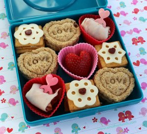 Seems like this consists of 3 heart sandwiches, 3 cracker piles, a strawberry, and a couple other things. Still, it kind of seems like a bit much for child's lunch box.
