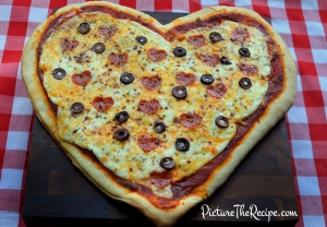 Now I like how they have heart pepperoni on this pizza. Yet, what's with the olives? Seriously, why?