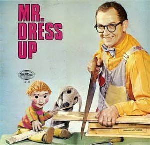 "Now this album is from a Canadian children's show by the same name that ran from 1967 to 1996. It bears a lot of similarities to Mister Rogers' Neighborhood. Yet, from the look of Mr. Dressup's face as he cheerfully saws his wooden plank, I sure don't want to be in his ""Neighborhood of Make-Believe."""