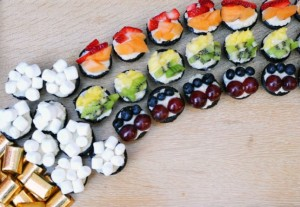 Toppings on these cupcakes include strawberries, cantaloupe, pineapple, kiwi, blueberries, grapes, and marshmallows. Yet, for a second, I thought this was some sort of rainbow sushi configuration.