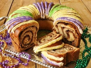 In some places, king cake is a dish pertaining to Epiphany which marks the end of the Christmas season. In New Orleans, it's a cuisine associated with Mardi Gras. Originally in France this was a dry French bread type dough with sugar on top and a been inside 300 years ago, it's now more or less a braided Danish cinnamon fried dough type with a small plastic doll underneath. Hundreds of these are consumed in New Orleans during the season and you'll see a lot of these.