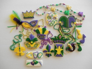 Now these come from a website called Custom Cookies.com so they're professionally made. Items include jester hats, jesters, crowns, the Fleur de Lis, beads, masks, and music notes.