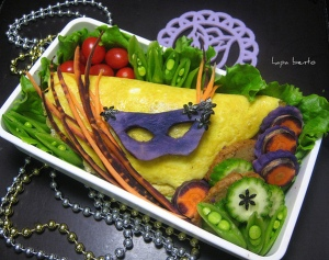 Of course, you can tell this is a Mardi Gras dish because the mask appears carved from some vegetable dyed purple as are some of the carrots. Nevertheless, very colorful.
