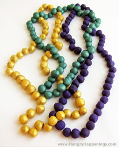 Come to think of it, truffle chocolate beads must be more expensive than regular plastic Mardi Gras beads you can find at any dollar store in your area. Yet, these seem to resemble beads from some higher end store.