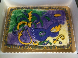 Of course, this cake has a lot of things we know of Mardi Gras like feathers, mask, confetti, Doubloons, and beads as you'd see in New Orleans. Also a background of green, purple, and yellow.