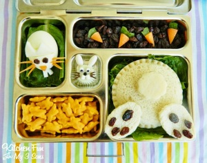 Seems like this lunch is all bunnied up with a rabbit going down its hole sandwich, a rabbit egg and jello, rabbit cheese crackers, and some carrots in raisin dirt.