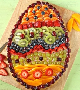 Now this is more of a dessert pizza with fruit toppings to decorate it over pink icing. Nevertheless, it's quite colorful.