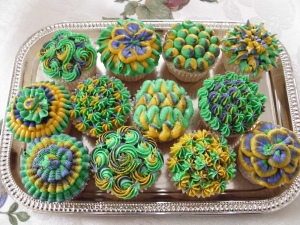 These cupcake icing designs were probably made by: a. a professional, b. a repressed art student, c. someone who's had too much of the Mardi Gras ganja, or d. all of the above.