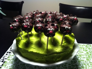 I like how all the groundhog cake pops are attached to this green cake, which I think is charming. Also, those groundhogs are quite cute if I do say so myself.