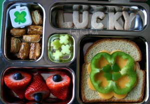 "Now this includes some 4 leaf clover jello and a sandwich with a cheese and pepper 4 leaf shamrock design. Also has ""LUCKY"" spelled out in bread."