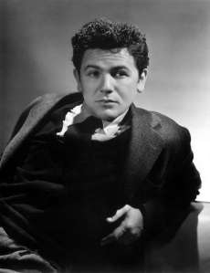 John Garfield was once a promising young actor known to play brooding, rebellious, working class characters. Yet, he made the unfortunate mistake of marrying a former Communist that resulted in him being blacklisted during McCarthyism, which cost his career.