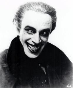 Before fleeing with his German wife to the UK, Conrad Veidt was already a prolific actor in the German film industry as well as international recognition. This goes especially true for his silent film roles. His character from The Man Who Laughs was an inspiration for the Joker.