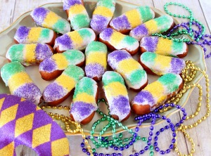 I know they look like custom designed Mardi Gras twinkies covered in icing, but hey, to each his own. Of course, consumed by New Orleans cops arresting people for public intoxication and indecent exposure.