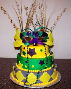 I like the gold party strings and the feather mask. I also like the stars on the cake as well as the yellow diamonds.