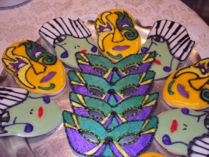 Of course, we have a couple designs of Mardi Gras masks along with a face with dangling notes and piano hair as I see it at least. Yes, these were undoubtedly made in the Big Easy.