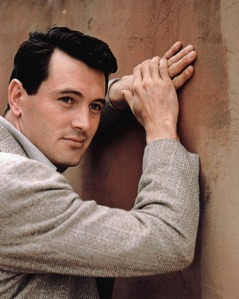 During the 1950s, Rock Hudson was a popular leading man with legions of female fans. However, we all know that he wasn't interested in any one of them since he was gay and would become the first major celebrity to die from AIDS. Also it was an open secret in Hollywood that his 3 year marriage to Phyllis Gates was a publicity stunt.