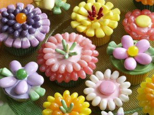 Now these cupcakes are decorated with Easter candy corn and jelly beans. But though these flowers may be pretty, the toppings may hardly be edible.