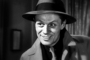 Richard Widmark's portrayal of Tommy Udo in Kiss of Death in which he pushes a poor wheelchair bound woman down the stairs has been ranked as one of the greatest villains in movie history as well as an inspiration for the Joker in Batman. Unfortunately, when nominated around Oscar time, Academy voters weren't very comfortable with having a guy win the Best Supporting Actor price to a man playing a complete psycho so they gave the Oscar to a man playing Santa Claus.