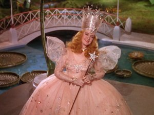Though there were actually 2 good witches in the L. Frank Baum source material, The Wizard of Oz writers decided to combine the two as Glinda, the Good Witch of the North and played by Billie Burke. Yet, when you watch the movie, this merge tends to have unfortunate implications regarding Glinda.