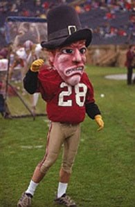 So this gives me an impression that John Harvard was present at the first Thanksgiving, died of some 17th century plague or was executed for witchcraft, and rose out of his grave as a zombie. Still, you'd think a prestigious rich kid school like Harvard would have a better mascot than this.