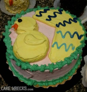 Okay, I know this is supposed to be a cake depicting a chick hatching from an egg. Yet, this more or less looks like a decorated Pac Man gone rogue for some reason.