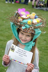 Oh, shit. She's an Easter bonnet contest winner during the High Clere Castle Easter egg hunt? Seriously, why wasn't there an Easter egg hunt episode of Downton Abbey then?