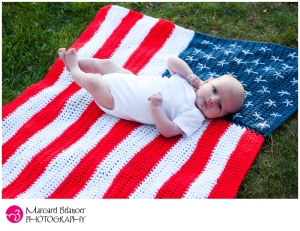 Sure this may be a heartwarming photo of patriotic cuteness. But the US flag code states you shouldn't let it touch the ground or put anything on it. Babies included.