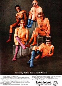 Yes, all that these guys have on are their hideous socks and their sunglasses. Still, I don't know if a group of naked men would look this comfortable around each other during a photo shoot. And you can almost see some of their butts.