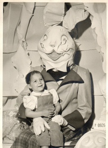 Okay, I think this rabbit is just plain terrifying. By the way, despite the kid having a butch haircut, that's definitely a girl because little boys didn't wear puffy sleeves like that in the day.