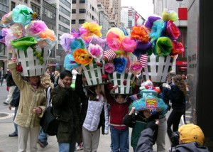 And it seems that these people might be in need of a major neck massage after they're done having these large flower laundry baskets on their heads all day.