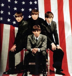 Gee, Beatles, this picture of the American flag seems all right with the union at the observer's left, but it's hung a little too low since the Fab Four are basically stepping on it. Then again, I'll just let them off this one since they're fantastic and British.