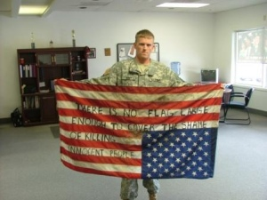 Now this soldier has his flag upside down to say our nation is in distress over the killing of innocents in the Middle East, which is fine. However, the writing on the flag is actually more disrespectful.