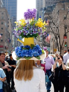 Now I wonder how does she wear this hat without straining her neck with all the weight of those plastic flowers I've seen in a cemetery.