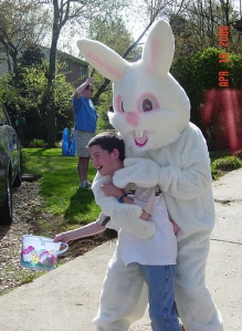 Seriously, that boy must be on something since nobody smiles when a giant ferocious Easter Bunny puts their arms around them before dragging them to their untimely deaths.