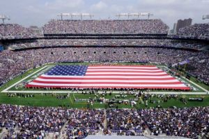 It's always a tradition in pro football games to display the American flag on the field. However, it's also a violation of the US Flag Code done in the name of patriotism. Then again, it looks good for the cameras.