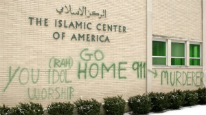 Here is an American Islamic center vandalized with words telling them to