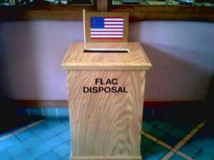 If you have an American flag that's worn out and torn to shreds, you can dispose it right in bins like these from organizations like the Boy Scouts, American Legion, VFW, the military, or others.