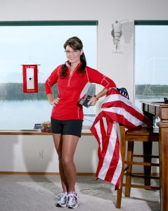 Hmm, Mrs. Palin, I know you love America and you want to take a photo to show it. But you know you're disrespecting the US flag by basically draping it on a chair. And she's among the same people who attack Obama for not wearing a lapel pin.